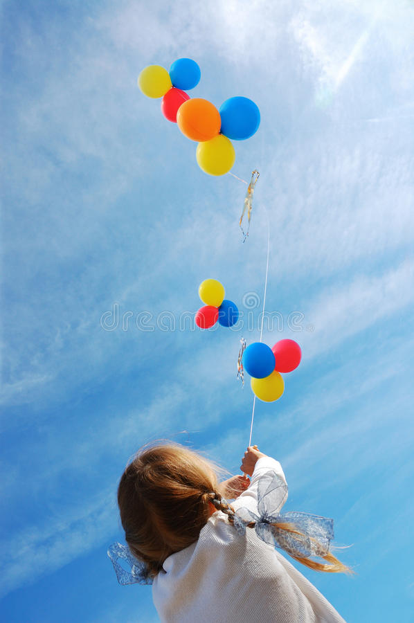 Child with balloons stock images