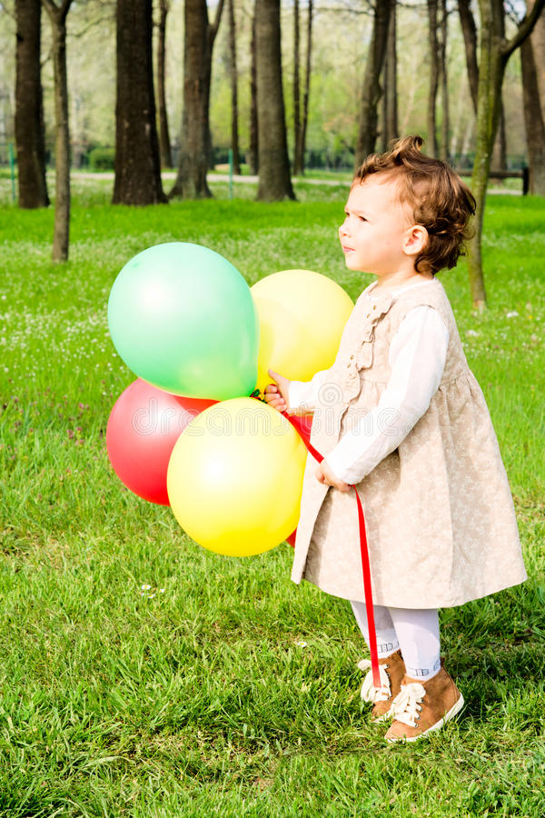 Child with balloons stock image
