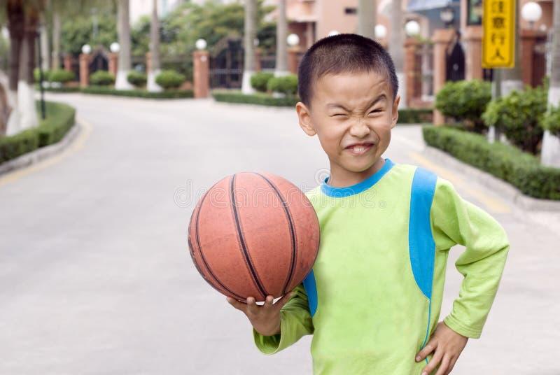 A child with a basketball stock photos
