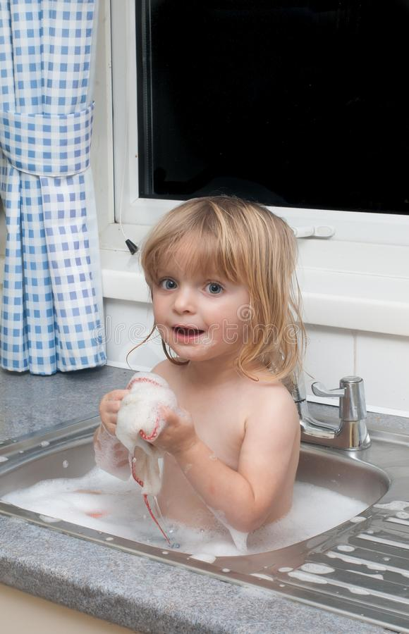 Child Bathing In The Kitchen Sink. Stock Photo - Image of childhood ...