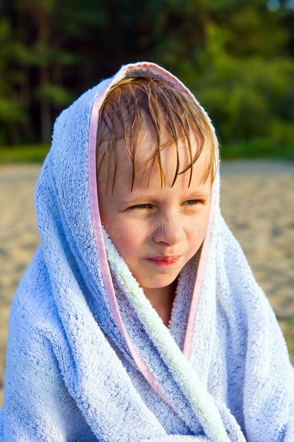 Child on the Beach. Little Kid in the Bath Towel on the Summer Beach royalty free stock photography