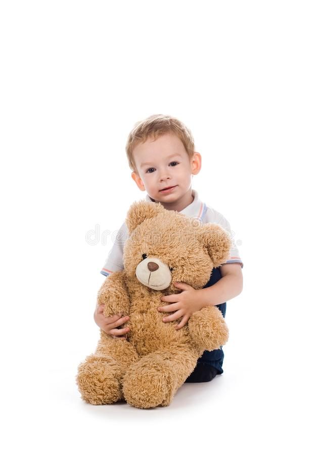 Child with bear stock photo