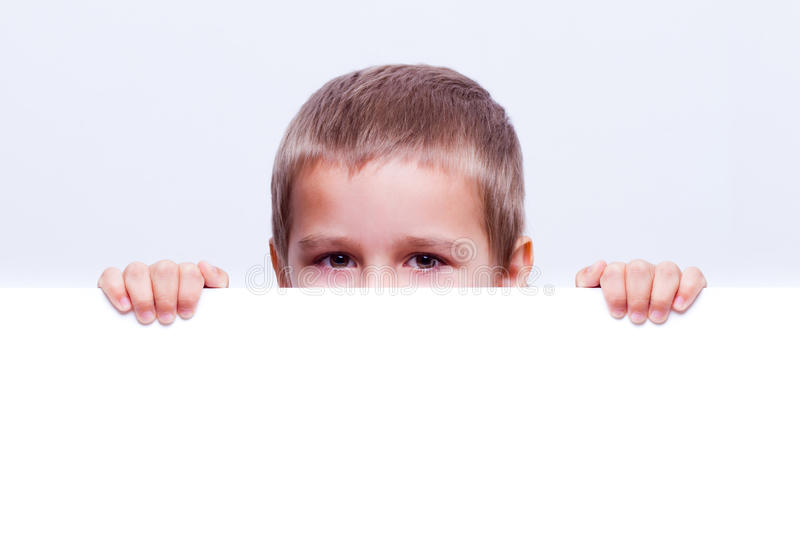 Download Child behind a white board stock image. Image of billboard - 28531021