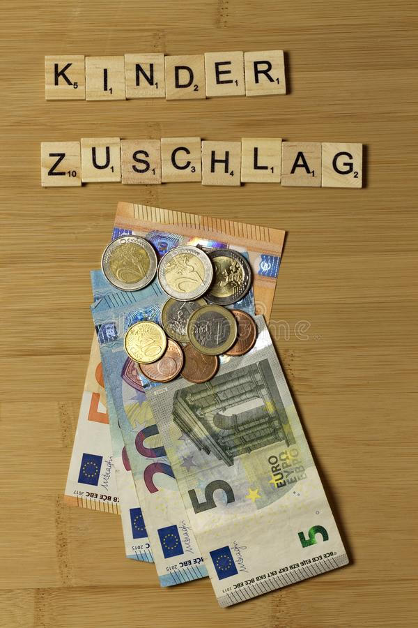 Child benefit allowance in german Kinderzuschlag. Euro banknotes on the table stock photos
