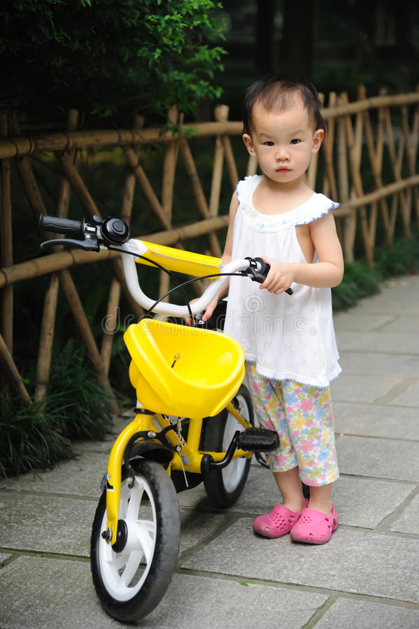 Child with bicycle