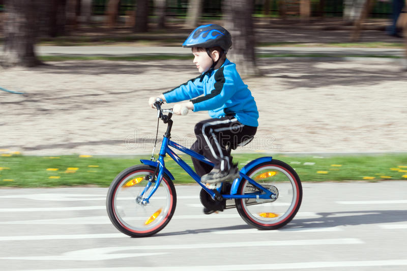 Child on a bicycle stock photo