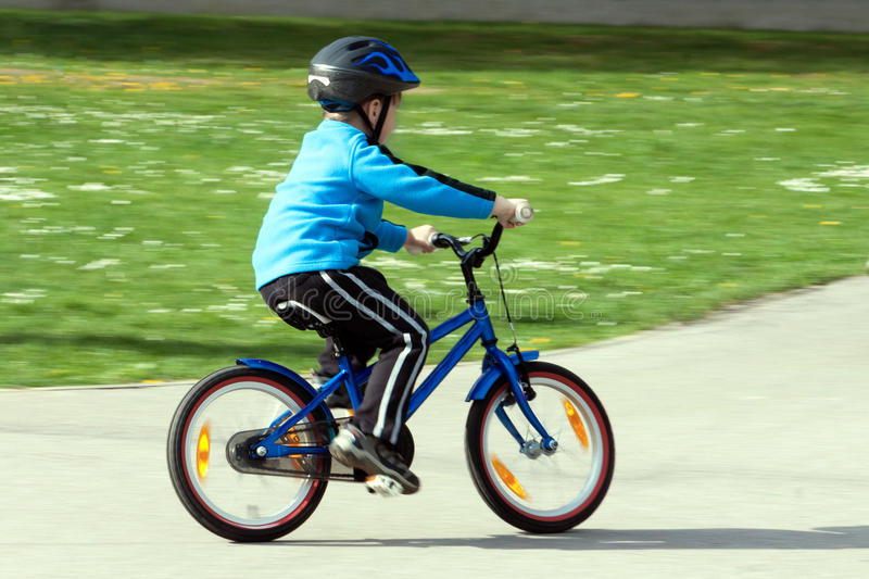 Child on a bicycle stock images