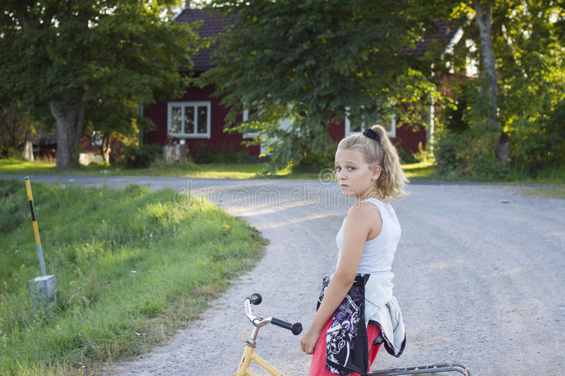 Child on bicycle on country road royalty free stock photos