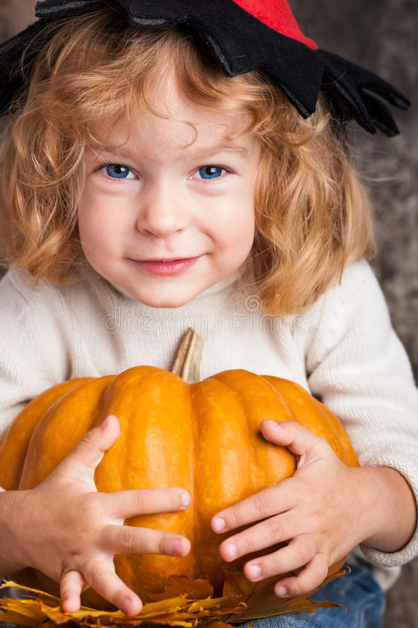 Child with big pumpkin stock images