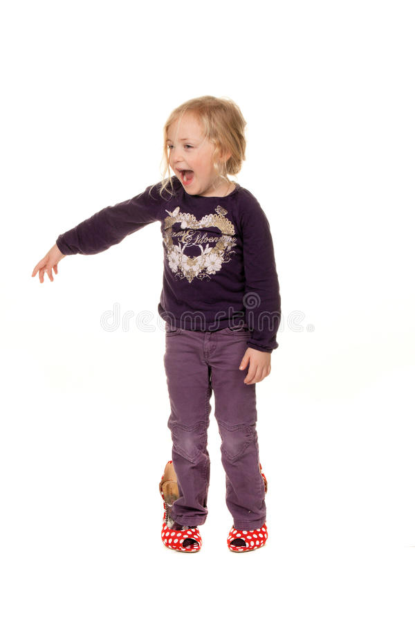 Child with big shoes. Funny baby with big shoes. Symbol for growth and future royalty free stock photography