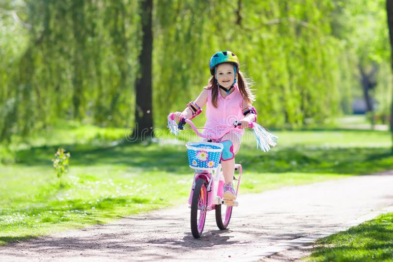 Child on bike. Kids ride bicycle. Girl cycling. royalty free stock images