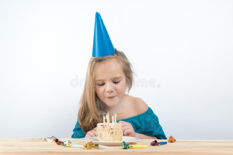 Child birthday. cake. holiday birthday cards. Blowing out the candles on the cake stock photos