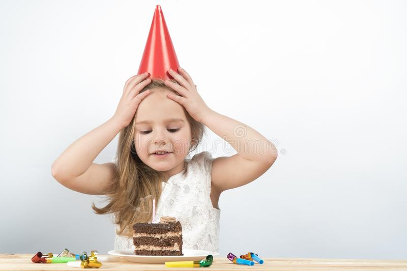 Child birthday. cake. holiday birthday cards. Little girl blows out the candles on the cake stock photo