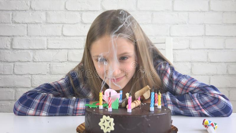 Child Birthday Party Blowing Candles, Children Anniversary, Kids Celebration royalty free stock image
