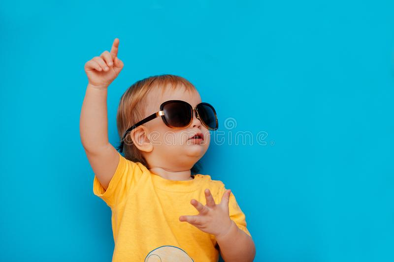 Child With Black Glasses Suggests Raises Hand With Index Finger. Stock  Photo - Image of beauty, business: 144834436