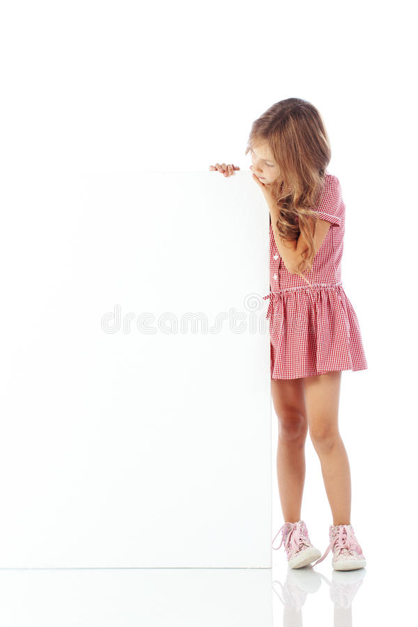 Child with blank board. Portrait of a child girl with blank board for custom text stock image