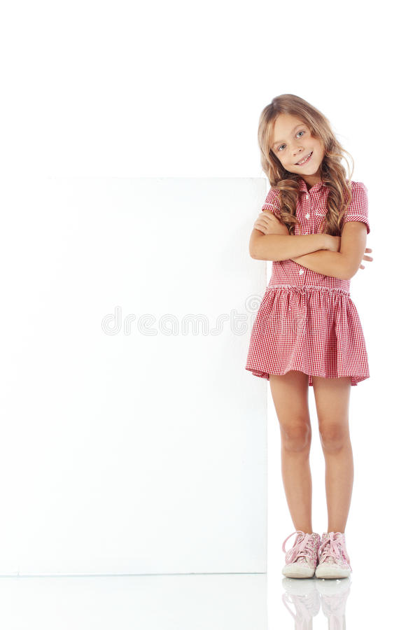 Child with blank board. Portrait of a child girl with blank board for custom text royalty free stock photo