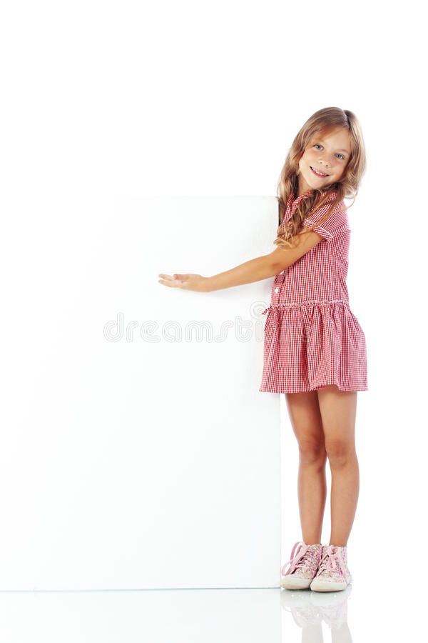 Child with blank board. Portrait of a child girl with blank board for custom text royalty free stock photos