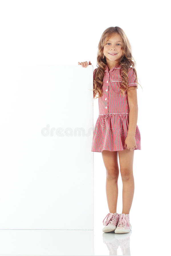 Child with blank board. Portrait of a child girl with blank board for custom text stock images