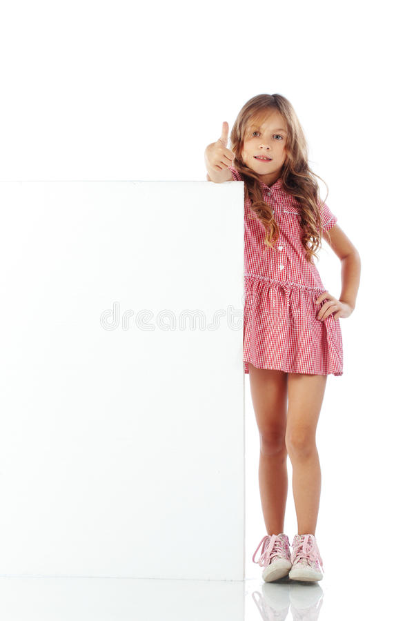 Child with blank board. Portrait of a school girl with blank board for custom text royalty free stock photography