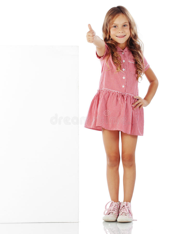 Child with blank board. Portrait of a school girl with blank board for custom text stock photography