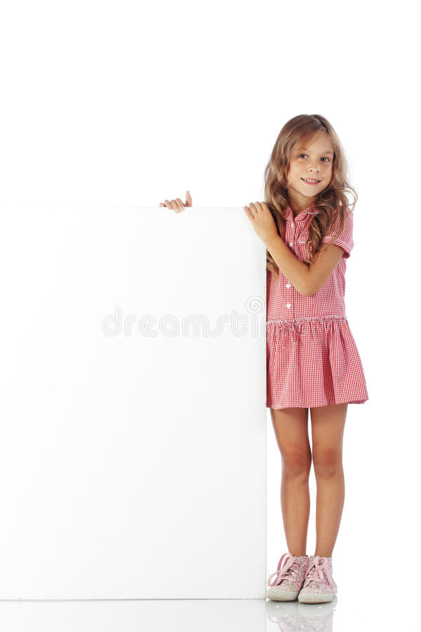 Child with blank board. Portrait of a school girl with blank board for custom text stock images