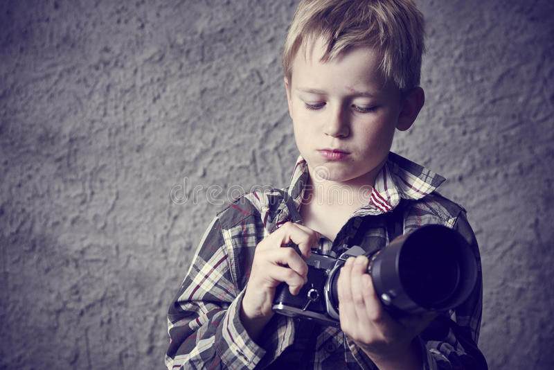 Child blond boy with Vintage photo film camera stock images