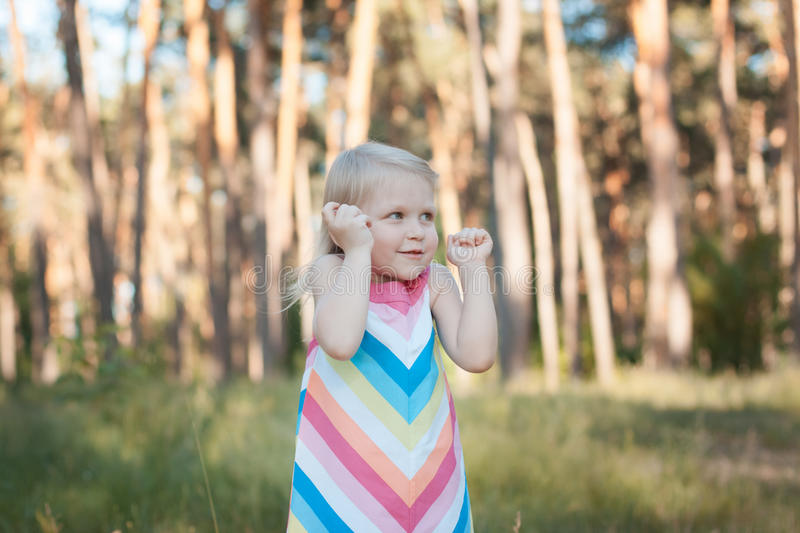 Child blonde in the forest stock image