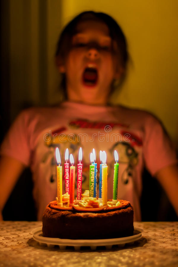 Child blow on birthday candles stock photo