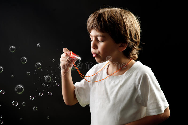 Download Child blowing soap bubbles stock photo. Image of child - 25712270