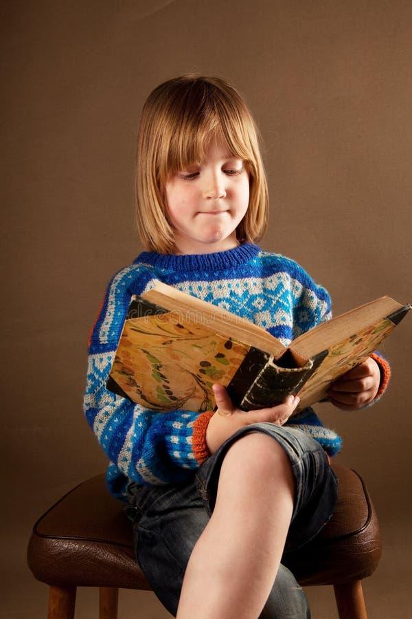 Child book chair studio royalty free stock photos
