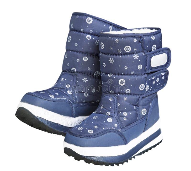 Child& x27; botas de neve do inverno de s isoladas no branco imagem de stock