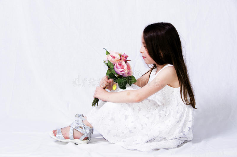 Child with a bouquet stock photos