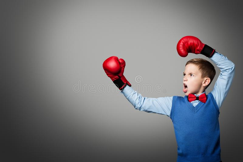 Child in Boxing Gloves, Elegant Kid Boy Boxer Raised Arms Up royalty free stock image