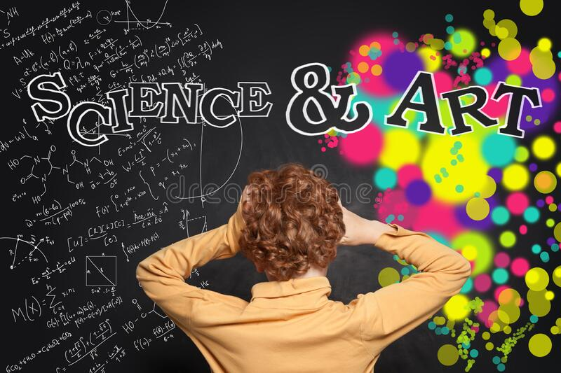 Child boy back on science and arts background on school chalk board stock photo