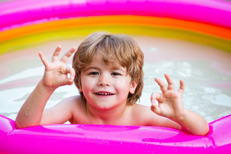 Child boy and best swimming pool. Child swimming pool. Children fun. Child water toys. Cute kid relaxing on swimming. Pool royalty free stock image