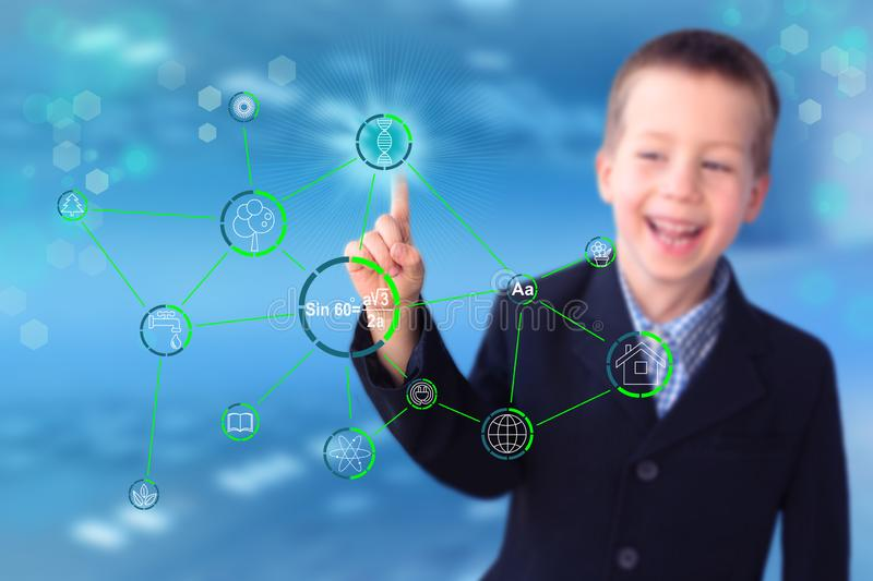 Child, boy, in a black business suit, businessman shows on a modern technological display the icon dna formula, concept medicine,. Science, determination of stock images