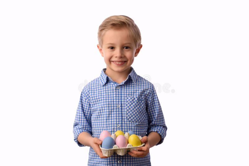 Child and Easter. Smiling blond boy, 6 years old, is holding a colors eggs. royalty free stock photos