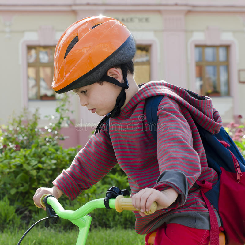 Child boy cyclling on bike royalty free stock photography