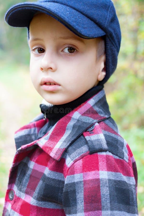 Child boy fashion portrait check coat royalty free stock images