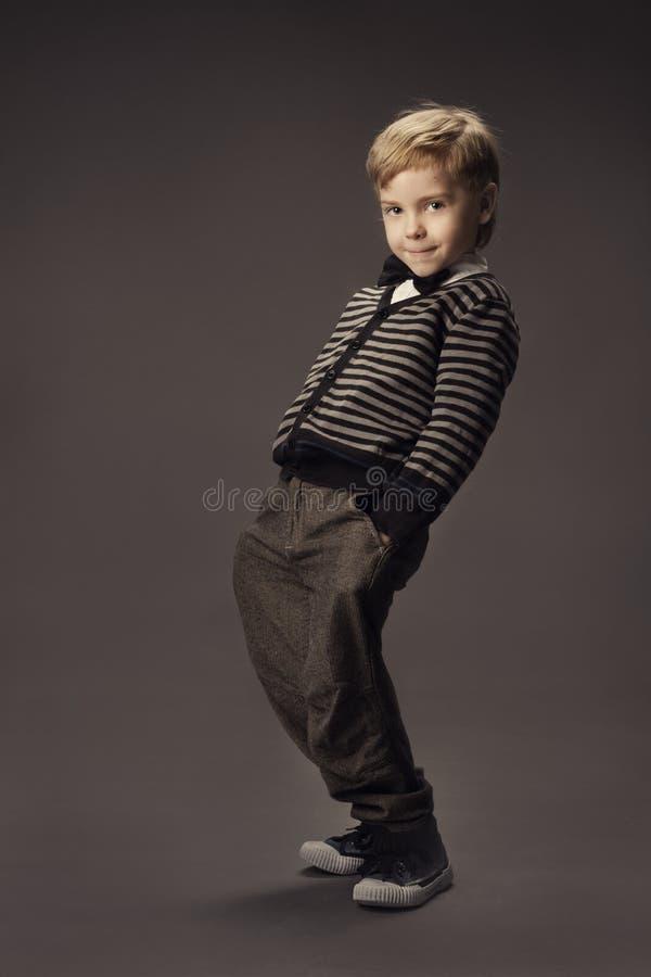 Child boy fashion studio portrait, kid smart casual clothing, ha. Nd in pocket stock photos