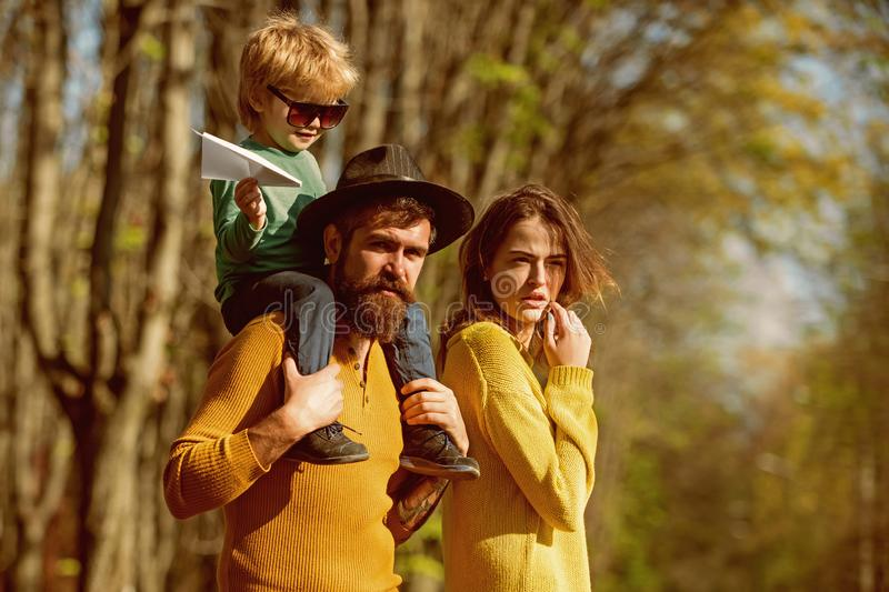 Child boy on fathers shoulder dream about flying high in forest. Little boy and family dream about travelling by plane. Lets get away from it all royalty free stock photos