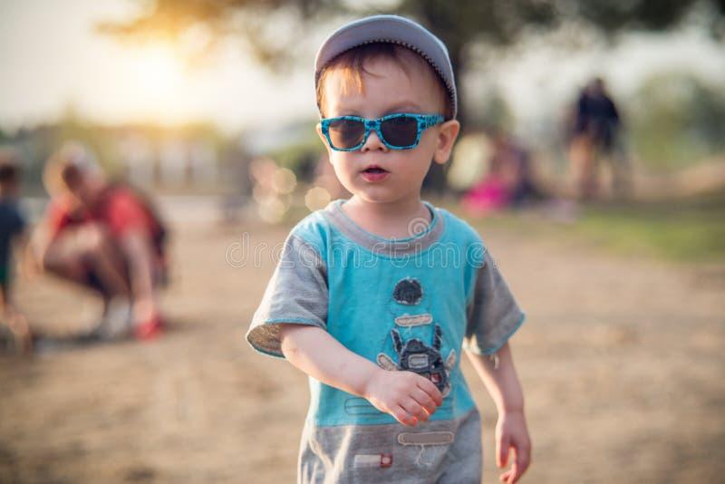 Kid boy beach portrait with sunglasses stock photography