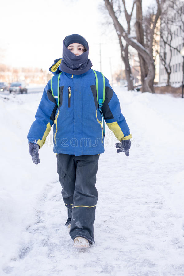 Child Boy on His Way to School During Winter stock image