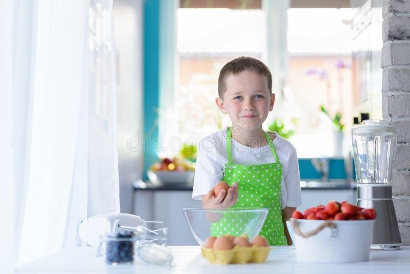 Child boy holding egg. stock photo