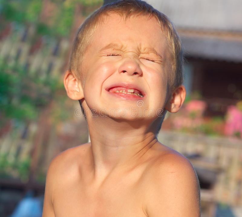 Child Boy making sore crying Faces showing Calf's Teeth Decay stock images