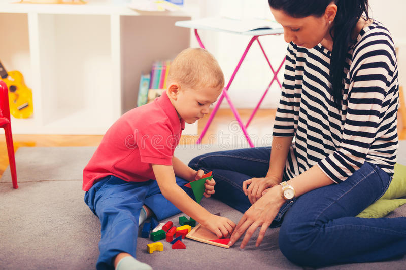 Child boy and mother playing stock photos