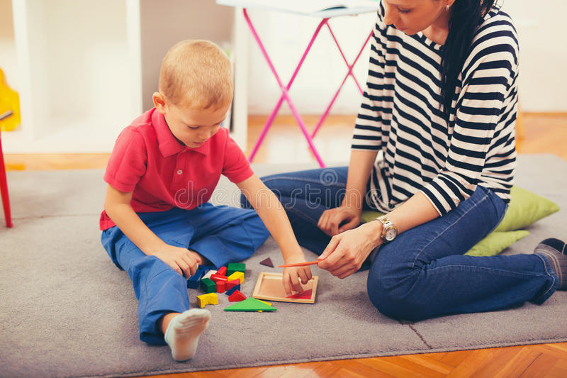 Child boy and mother playing stock photo