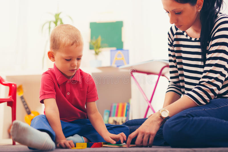 Child boy and mother playing royalty free stock photography