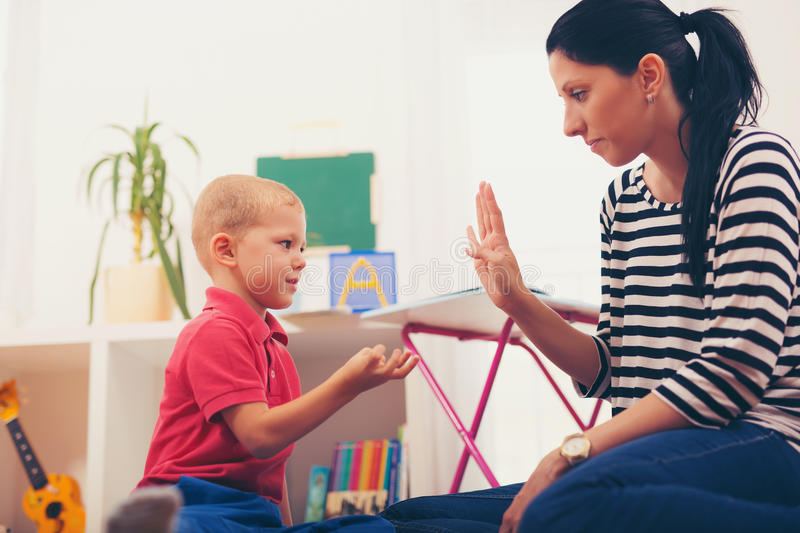 Child boy and mother playing royalty free stock images